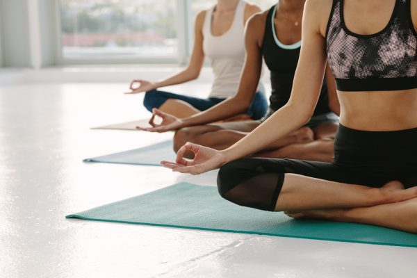 Females meditating in Padmasana at yoga class